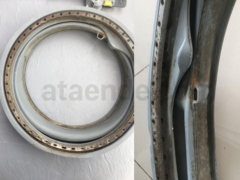 kerak dan noda pada karet pintu mesin cuci